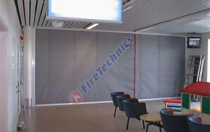 Фотографии экономичных противопожарных штор FireShield-EI120, Объект: офисный центра, Габариты системы: 7,5 х 3 м.